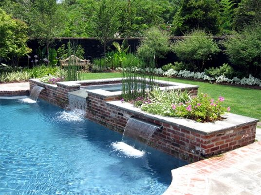 Classic brick and blue stone pool with raised planter and