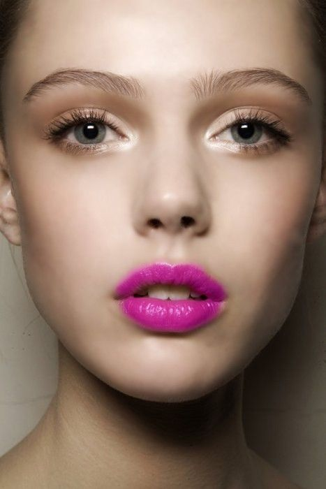 Glossy fuchsia lips with soft gold shimmery eye makeup.