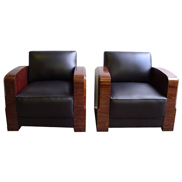 Fantastic pair of Art Deco chairs in black leather and polished wood circa 1920. Dimensions:  30H x 33W x 33D