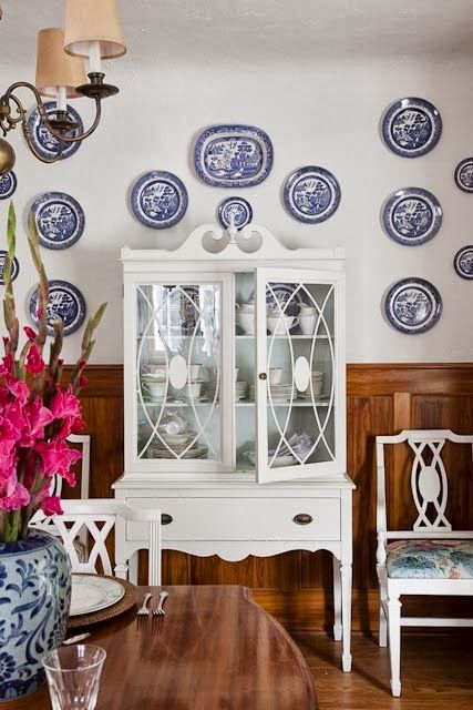 blue and white plates as wall decor