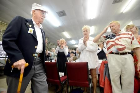 """Lt. Col. Ed Saylor, left, visited the Fort Walton Beach Chamber of Commerce during the Doolittle Raiders' last """"official"""" reunion in April 2013 in Fort Walton Beach, Fla. Saylor, one of the last four members of the legendary Doolittle Raiders, passed away Wednesday, Jan. 28, 2015, at his home in Enumclaw, Wash. He was 94. (AP Photo/Northwest Florida Daily News, Nick Tomecek)"""