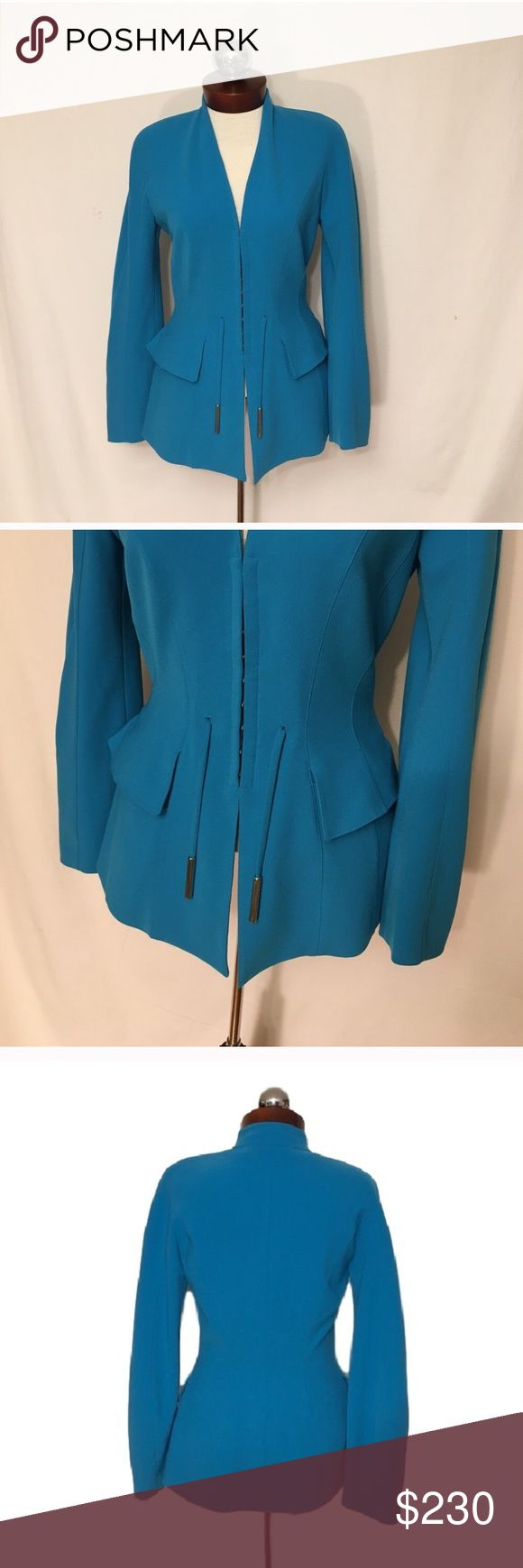 Thierry MUGLER $2300 hook eye logo fitted jacket Thierry MUGLER jacket bright logo pulls 36  Jacket shows two dots of slight discoloration at the left sleeve, as shown in photos. Wear to intetior tag. Otherwise, excellent condition!    light shoulder padding   Fully lined  multiple hook/eye closures at front  MUGLER at silvertone drawstring pulls  *matching pants (36) are available, if interested. Will require seam repair. Please inquire for measurements and photos.   Jacket Measurements in…