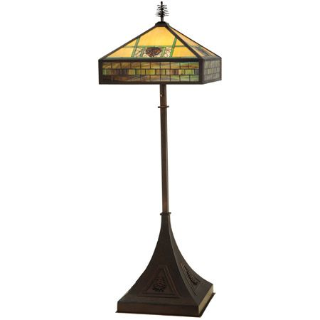 A truly unique craftsman floor lamp that stands 81 inches tall and 26 inches wide, and takes four bulbs. The shade is made of stained glass with a pine cone design and is topped by a pine cone finial. The massive, yet gracefully curved, base has pinecones on it in relief. This lamp would be the centerpiece of any room.