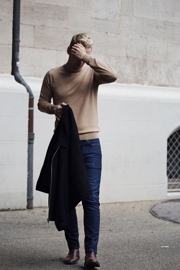 MENSWEAR street style fashion: camel cashmere sweater from John Smedley, casual blue denim jeans, classic brown chelsea boots, smart black jacket.