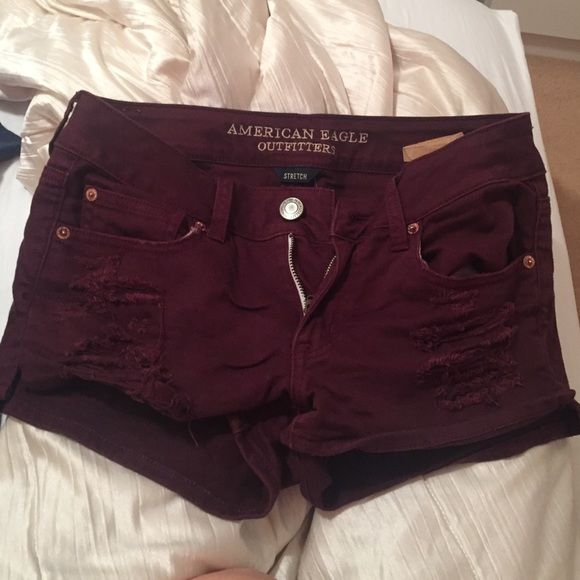 Maroon Ripped Low Rise Jean Shorts maroon, size 4, never worn American Eagle Outfitters Shorts Jean Shorts