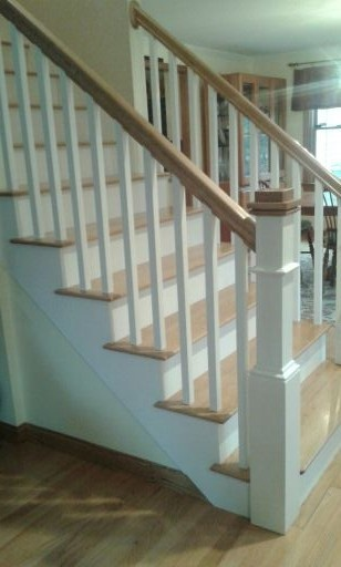 Craftsmen staircase After!  From carpeted builder quality stairway to hardwood Craftsmen style elegance! Everyone needs a contractor like Mike McCall!