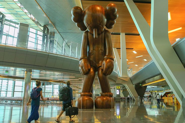 The 32-foot sculpture by the artist KAWS makes a grand entrance with its public reveal at Hamad International Airport.