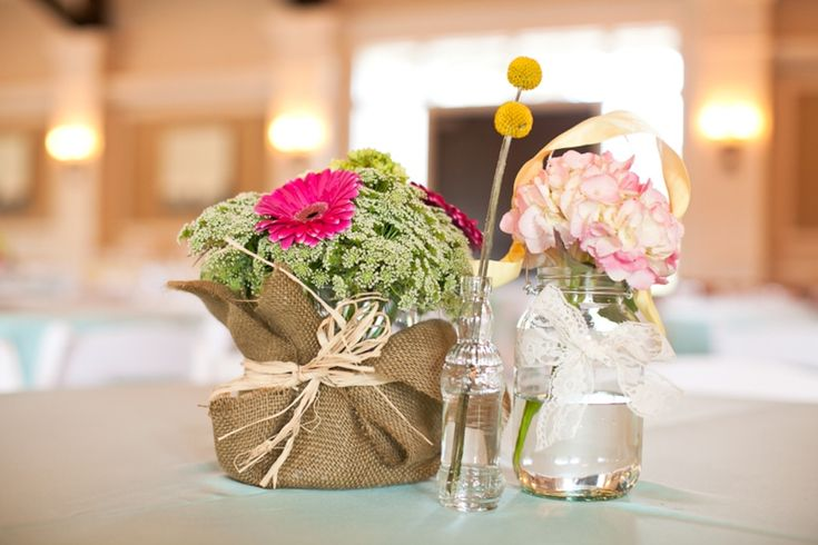 pink and yellow centerpiece with burlap and lace accents