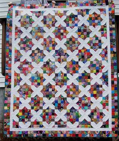 """A scrappy quilt using Arkansas Crossroads blocks. Great for using up """"ugly"""" fabrics. #craftster"""