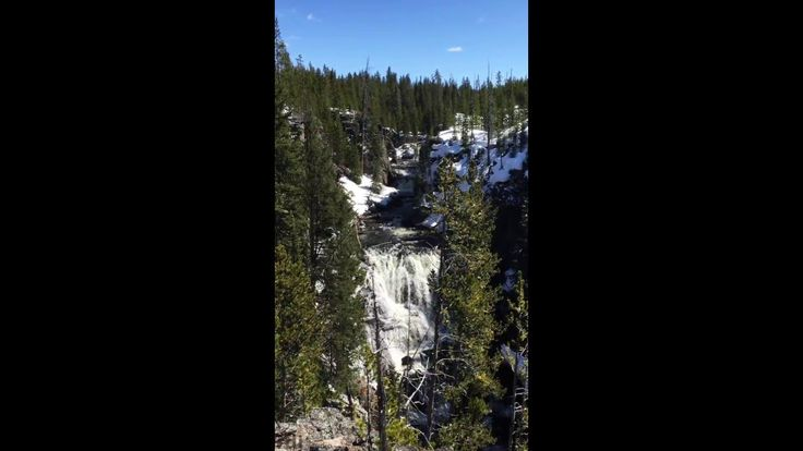 The Firehole River plunges over the Kepler Cascades in Yellowstone National Park.