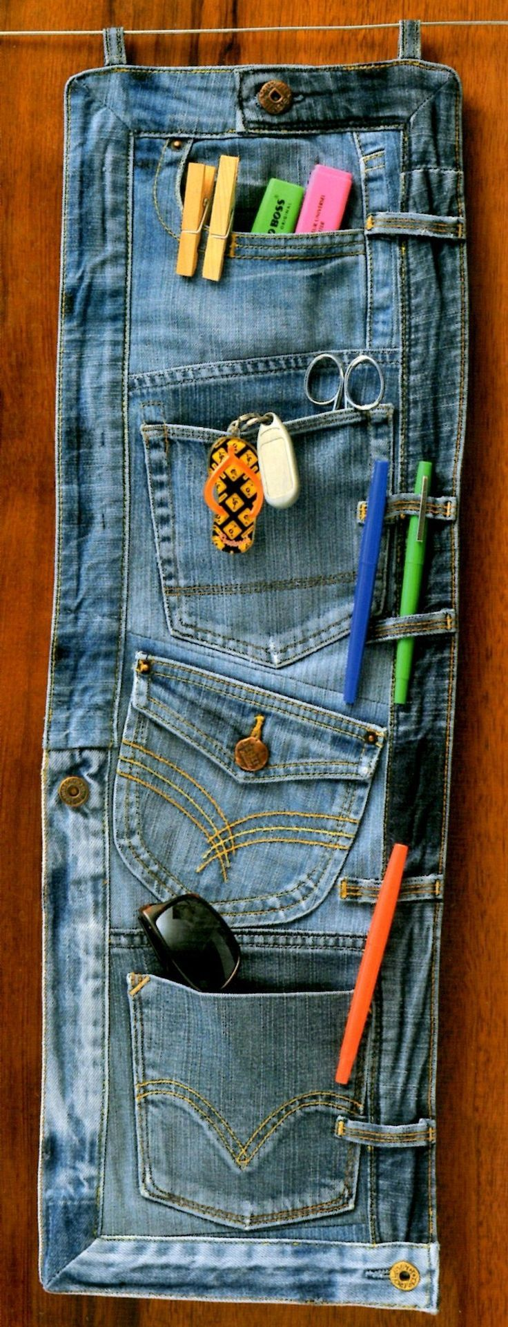 How to recycle an old bluejeans into an organiser. Look for jeans at your local #Goodwill Store! www.goodwillvalleys.com/shop/