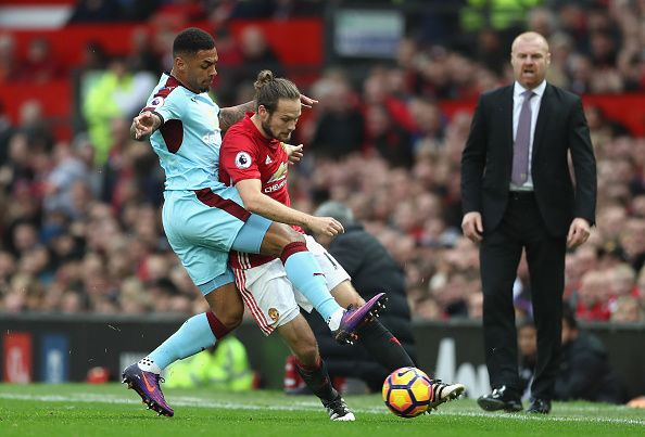 Andre Gray of Burnley and Daley Blind of Manchester United battle for possession during the Premier League match between Manchester United and...