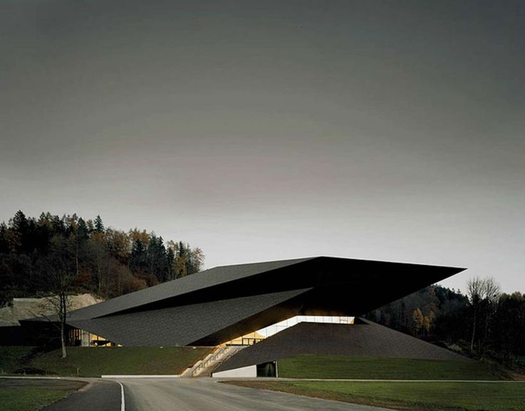The festival hall's geometry develops from the surrounding topography and places the building and the already existing festival hall in juxtaposition. Its p...