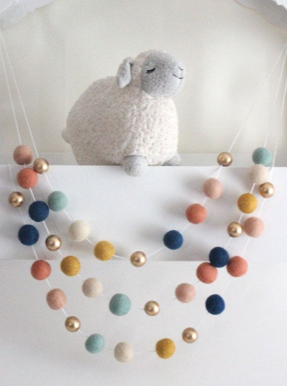 This colorful luxe felt ball pom pom garland with golden wooden bead accents features the following colors to decorate your baby shower, birthday