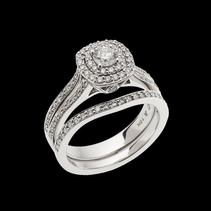 """""""Cashmere"""" has a double-halo of diamonds to amplify the center round brilliant diamond. This ring has a 0.25 carat round brilliant center diamond."""