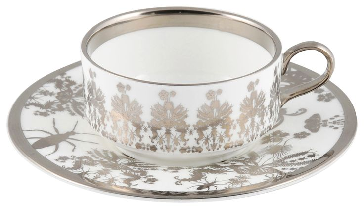 Entomo' Platinum Mocha Cup & Saucer – a small set full of detail taken from the 'Entomo range. Designed by Monica Tsang, 'Entomo' presents an array of some of the most important yet often misunderstood creatures on our planet. From gossamer wings of the butterfly to the architectural magnificence of the stag beetle, together a pattern of wonderment and delight. Hand gilded platinum rim and details. Available in Platinum and Black. Handwash Only. Made in Stoke-on-Trent, England. Fine Bone…