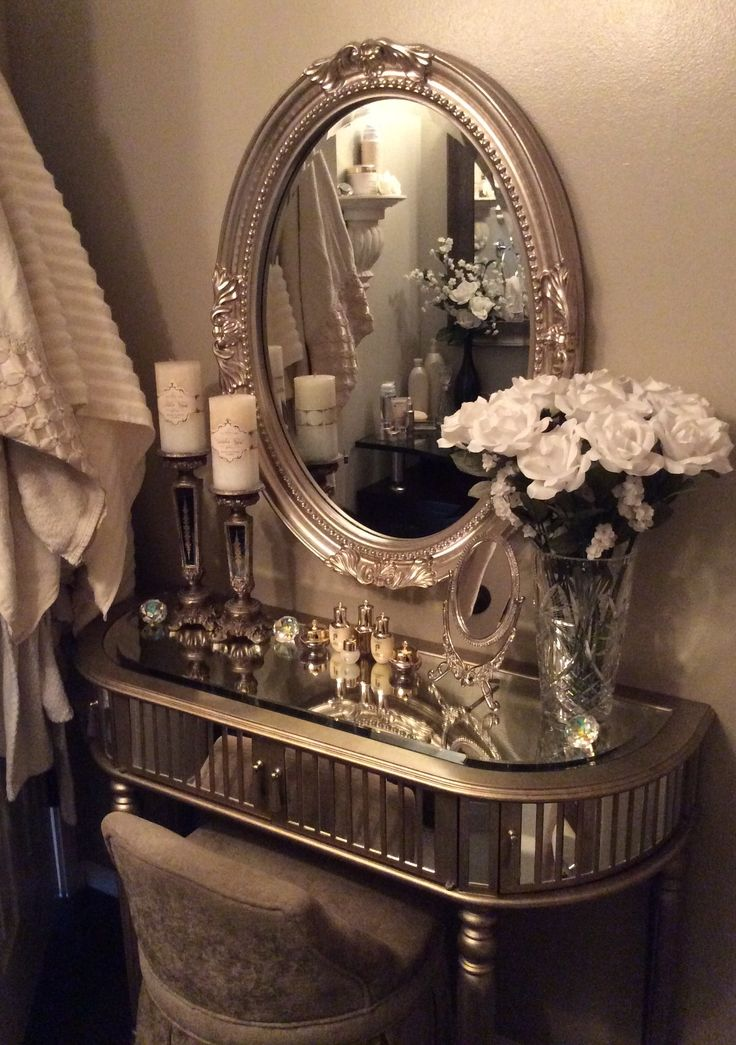 Small bathroom luxury mirrored vanity and chair
