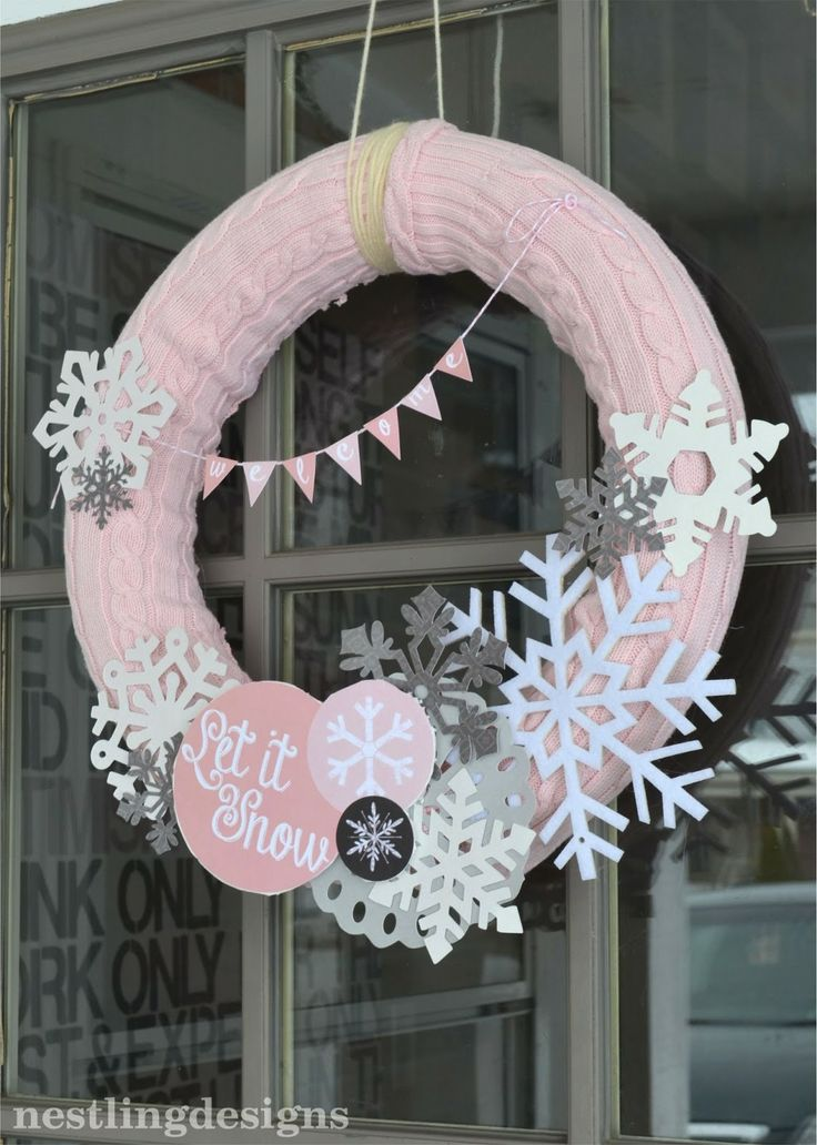Snowflake wreath made using a pool noodle, sweater from goodwill, and some ornaments