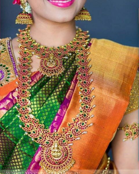 South Indian bride. Gold Indian bridal jewelry.Temple jewelry. Jhumkis. Green and orange silk kanchipuram sari. braid with fresh jasmine flowers. Tamil bride. Telugu bride. Kannada bride. Hindu bride. Malayalee bride.Kerala bride.South Indian wedding.