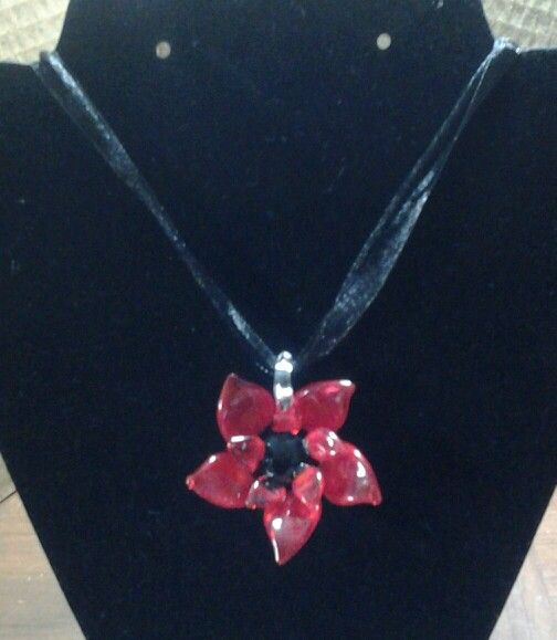 Res glass poinsetta on black cord and ribbon  $10.00