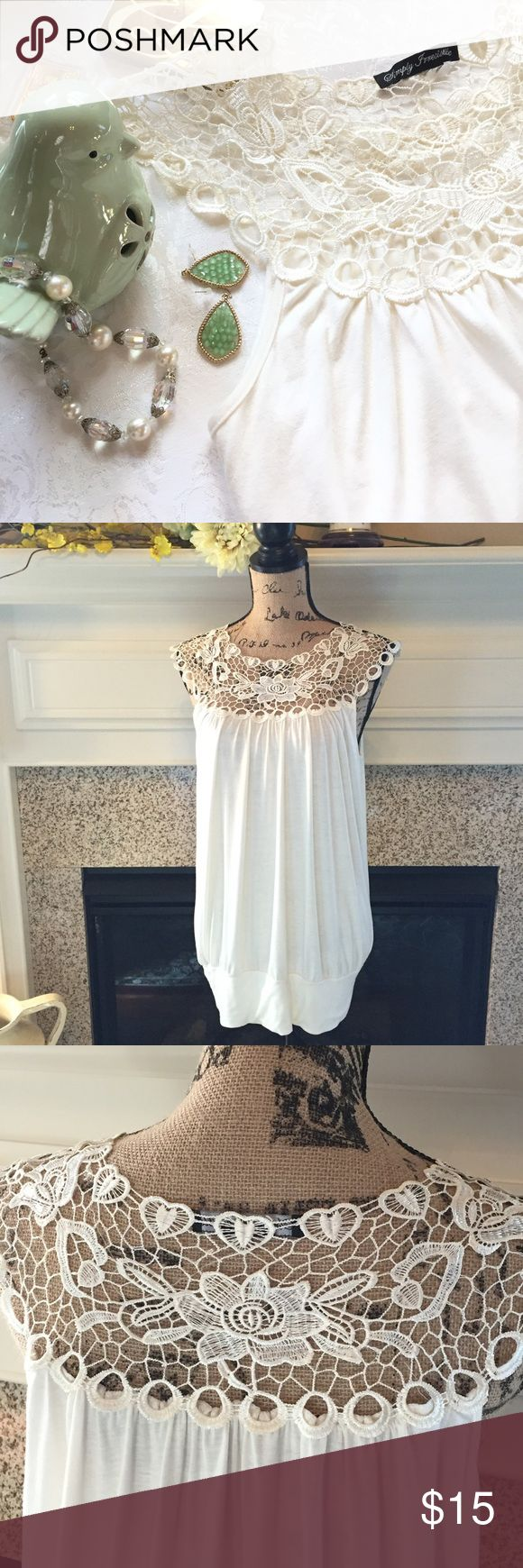 Simply Irresistible Women's Top Cream colored top with banded hem, soft polyester blend fabric, beautiful crocheted neckline, the tag was removed but should be a medium, measured flat, bust 20 inches and 29 inches from shoulder to hem, looks new, perfect with a pair of beige linen pants and flats SIMPLY IRRESISTABLE Tops Tunics