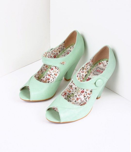 Shelly has our full attention, darlings! These vintage inspired mint Mary Jane heels are crafted in leatherette and feature a flirty peep toe and 4 pump for an elegant lift. The charming strap secures with a large button while the soft cushion interior k