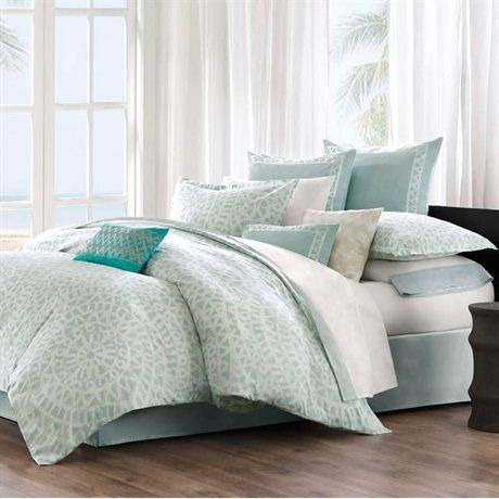 This Mykonos bed set by Echo brings a calm feeling to the bedroom. The oversized comforter is made from 100% cotton with a mosaic tile design. The top of bed is complete with a  tackless finish on the edge for a clean look. The decorative pillows pull several shades of green together to give dimension and color to this bed set.