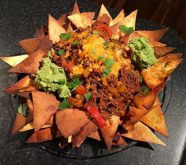 When Mrs the_beltsander says she wants nachos she gets nachos......grande.  Nacho platter with extra cheese and fresh guacamole.  Now if I could only get the time to eat it between the screaming newborn in my house and the legions of children knocking my door down.  1/2: Calories:1048 Fat:52 Carbs:74 Protein:70  Recipe for my macro friendly nachos is included in my second eBook.link is in my bio above for a preview of what's waiting inside