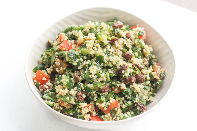 Take a bite into this refreshing, gluten-free quinoa spinach salad bursting with colourful tomatoes, cucumbers and raisins dressed with a lemon vinaigrette.