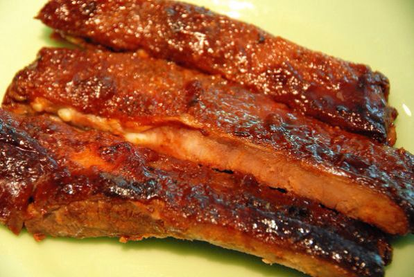 Danielle's Ribs- Put the racksof ribs in a casserole dish in a single layer.  Brush with bullseye BBQ sauce. Add 1/4 cup water, cover with foil and bake at 350 for 90 minutes. Remove, cut into individual ribs, brush generously with more sauce, cover and put back in oven for 30 to 45 minutes.  Enjoy!