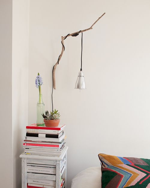 "more info on the lamp-on-a-stick:  ""I saw a branch lamp online and was on the hunt for the perfect branch for a long time. I finally found it during a jog by the East River. An old Ikea lamp wrapped around it worked perfectly.""--lotta nieminen, featured on Design Sponge's Sneak Peeks home."