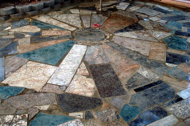 """op: """"free granite pieces from Craig's List turned into a beautiful patio. All the work was done by my teenage son, his girlfriend and my husband and I. The only cost was $12.50 for the decomposed granitewe used for the 'grout'..."""""""