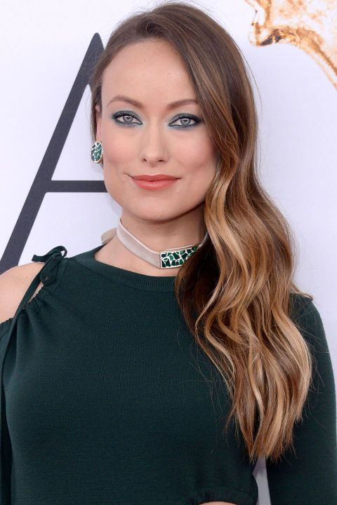 The Best Beauty Looks from the CFDA Awards: Olivia Wilde's side swept locks and emerald eyes.
