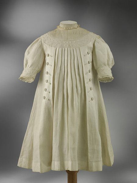 A beautifully pleated girl's linen dress made in Greece circa 1910.