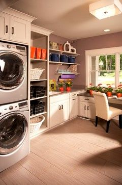 If your washer and dryer aren't super loud, you could definitely craft in your laundry room, given the size here.