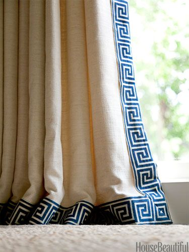 """A Greek key border, Clarence House Grand Galon Athenee, """"crisps up the edges"""" of curtains in a Houston house for a young family. Because curtains often require more fabric than people realize, """"If a client has an expensive fabric they love, I sometimes buy just enough to do a two- to four-inch-wide border,"""" designer Ann Wolf says. """"You'll get the look of the fabric without the expense."""""""