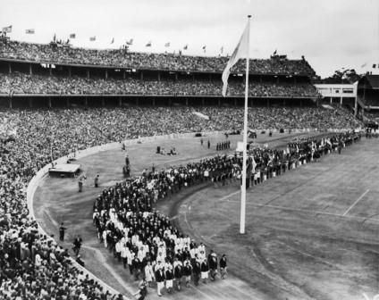 Olympic athletes march together during the closing ceremony of the Melbourne Olympics, Melbourne Cricket Ground, 1956