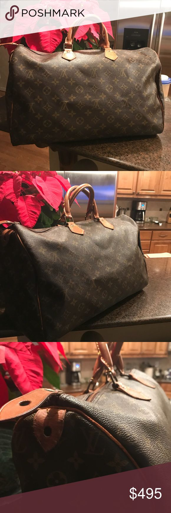 Beautiful Vintage Louis Vuitton Speedy 40 Beautiful Vintage Louis Vuitton Speedy 40.  Canvas is in good condition, Beautiful Vachetta leather has darkened with age.  End tabs are in tack but have some fold cracks.  Inside is clean.  Datecode VI881 Louis Vuitton Bags Totes