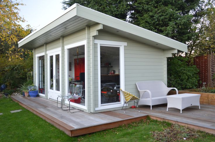 Stunning garden office with decking, meeting room, bar and chill out area. This garden office has a very subtle colour scheme, with pale grey/green walls and white washed edging.
