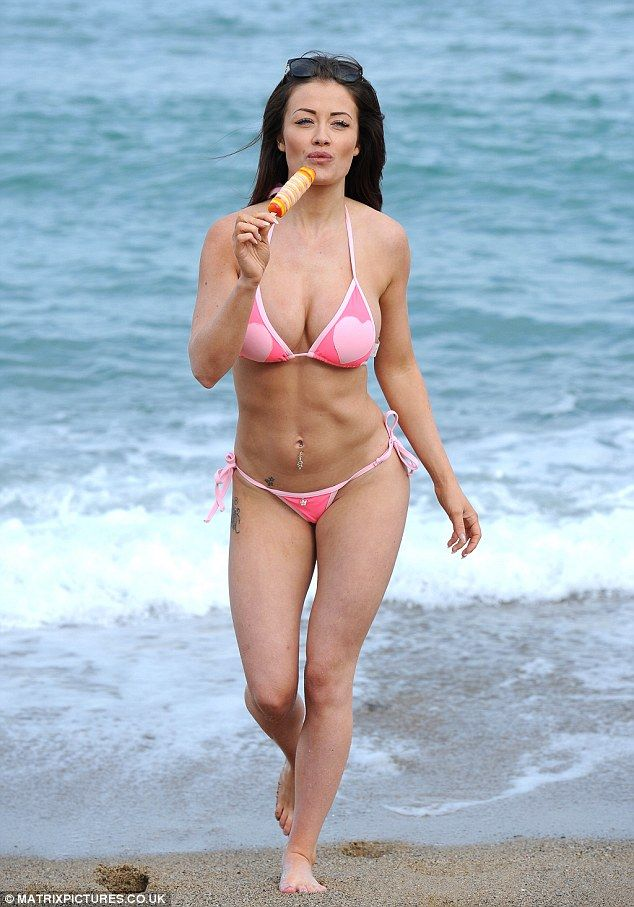 Tanned and toned: Her taut tummy and various tattoos were also highlighted thanks to her choice in swimwear