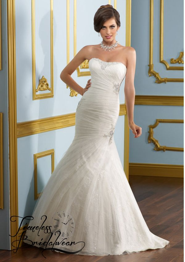 Mori Lee 4907. Size 14 & Under Only €850!  Absolutely Stunning Strapless with satin and tull ruching. Lace up back. The appliques create sophisticated elegance and that subtle touch of bling!
