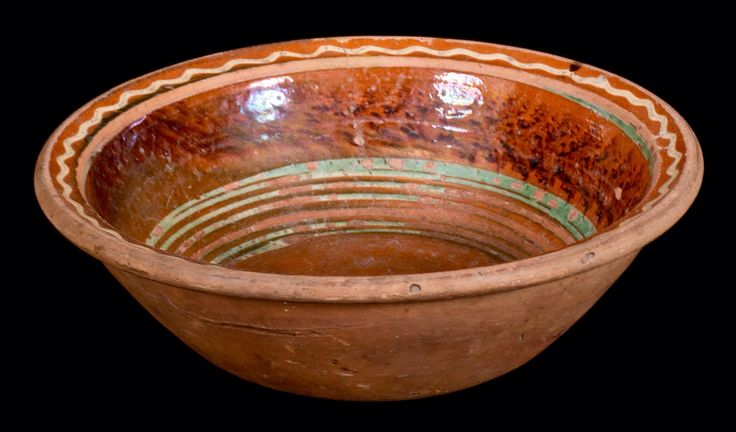 Crocker Farm 3/19/16 Lot # 423 (profile).  Realized: $144 ($125 hammer, plus 15% buyer's premium).  Glazed Redware Bowl with Three-Color Slip Decoration, Mid-Atlantic origin, second or third quarter 19th century, tapered bowl with semi-rounded rim, the interior decorated with several bands of copper slip below a wide band of manganese sponging. Rim area decorated with a wavy band of cream-colored slip above a band of copper slip. Wear to interior, including heavy losses to copper slip below…