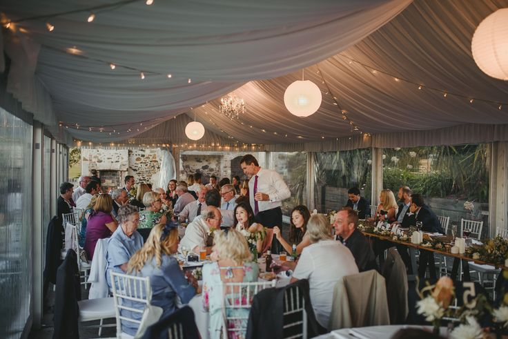 silk lining, fairy lights, rice paper lanterns, chandeliers, clear walls, tiffany chairs, round tables, south coast weddings, south coast party hire