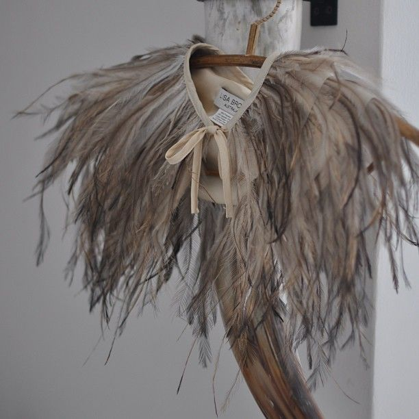 .Lisa Brown feather cape…. this is AWESOME!!