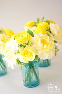 pretty flowers clay   vintage linens blue and yellow Blue and Yellow Wedding Centerpieces blue and yellow baby shower centerpieces