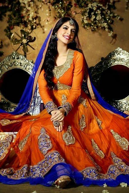Bright orange Salwar Kameez with blue, silver & gold embroidery and indigo blue shear trim & Dupatta.