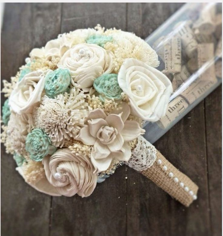I love the burlap wrapping here, which I would want on all of the bouquets (bride, bridesmaids, blessed mother).