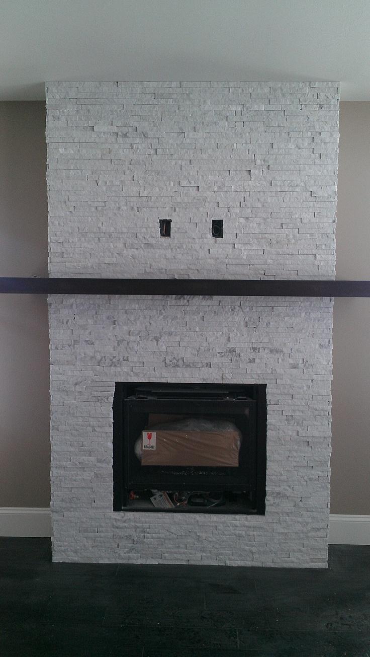 Marble Ice split stone veneer fireplace