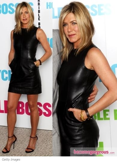 Black leather dress - I think she looks absolutely stunning in this with those toned/tanned legs!