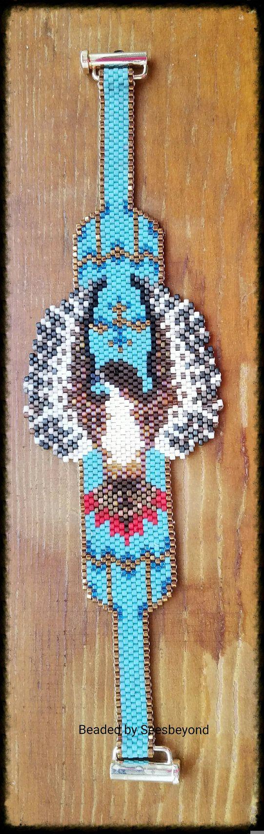 Bracelet en perles à la main rouge queue de faucon par seesbeyond